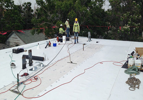 men working on modified roof